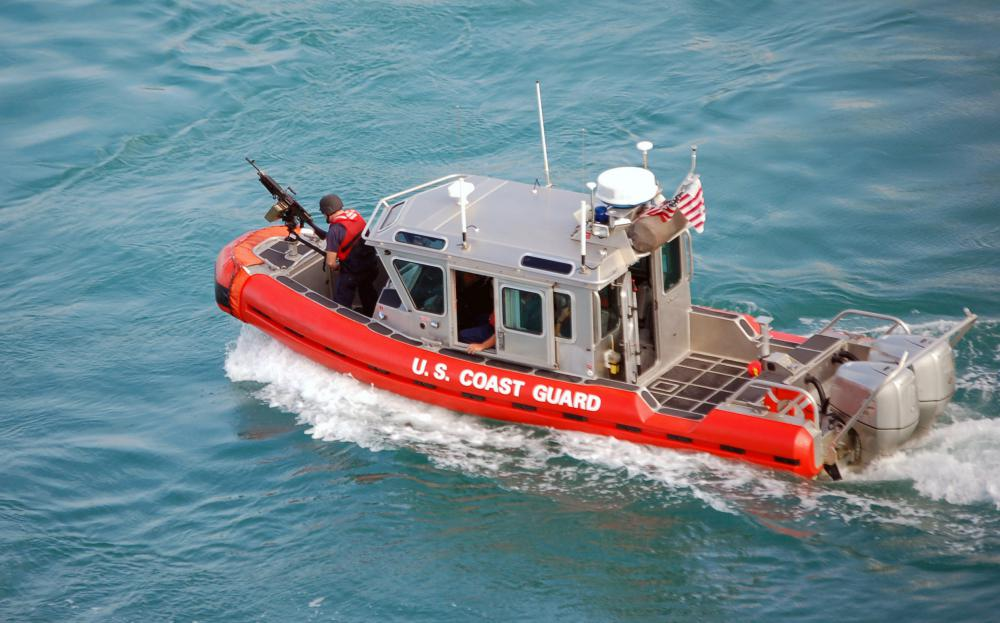Longshoremen must occasionally interact with U.S. Coast Guard harbor patrols to ensure that docking areas are secure.