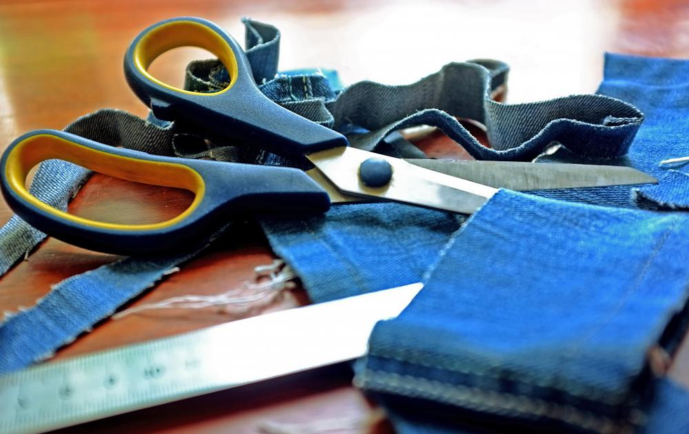 A tailor makes suits and other clothing fit a customer's body by cutting or adding and stitching fabric.