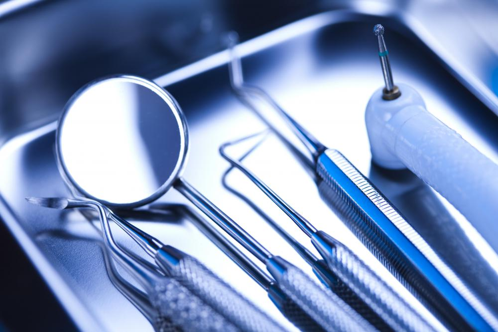 Dental hygienists use several tools during a routine dental cleaning.