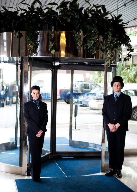 A hotel porter may serve as a doorman for guests.