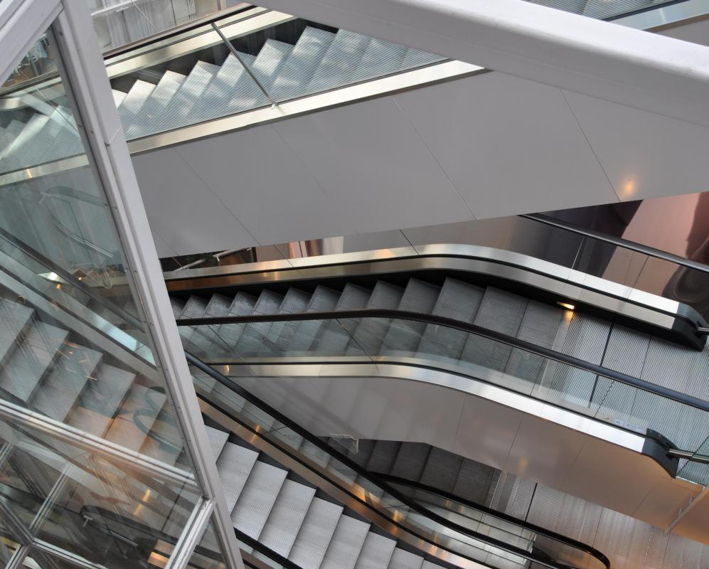 A mechanical engineer might be employed to design a building's escalators after a structural engineer finishes his work.