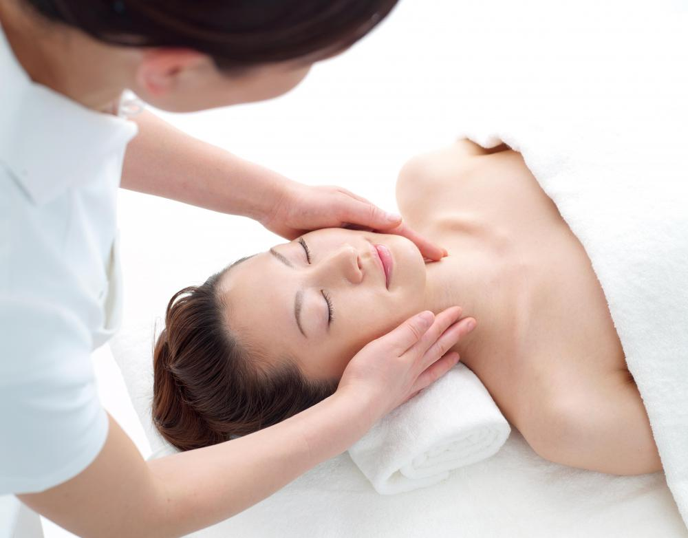 An esthetician may give facials to clients.