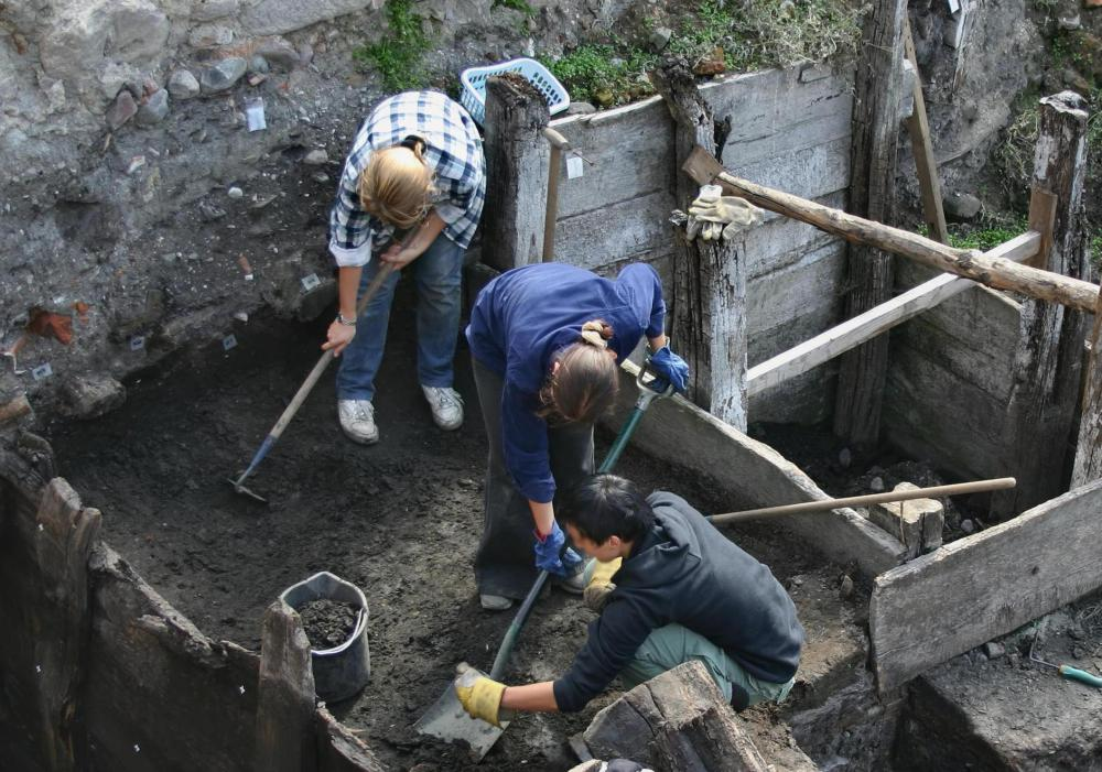Archaeologists on a dig site.