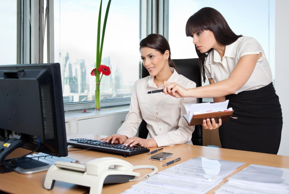 An executive assistant may coordinate her supervisor's schedule.