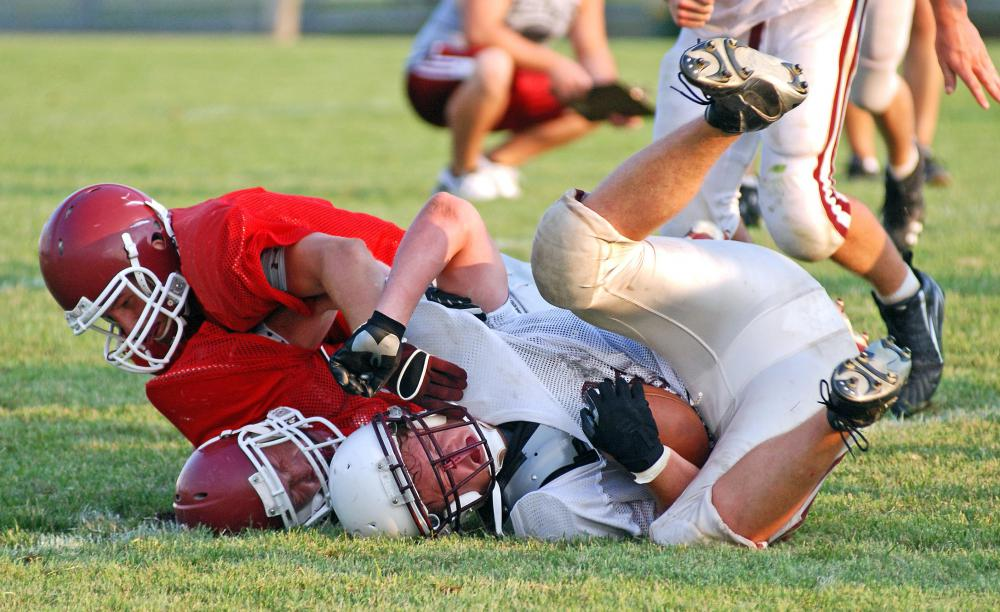 Sports medicine physicians may work with local schools to make sure student athletes stay healthy.