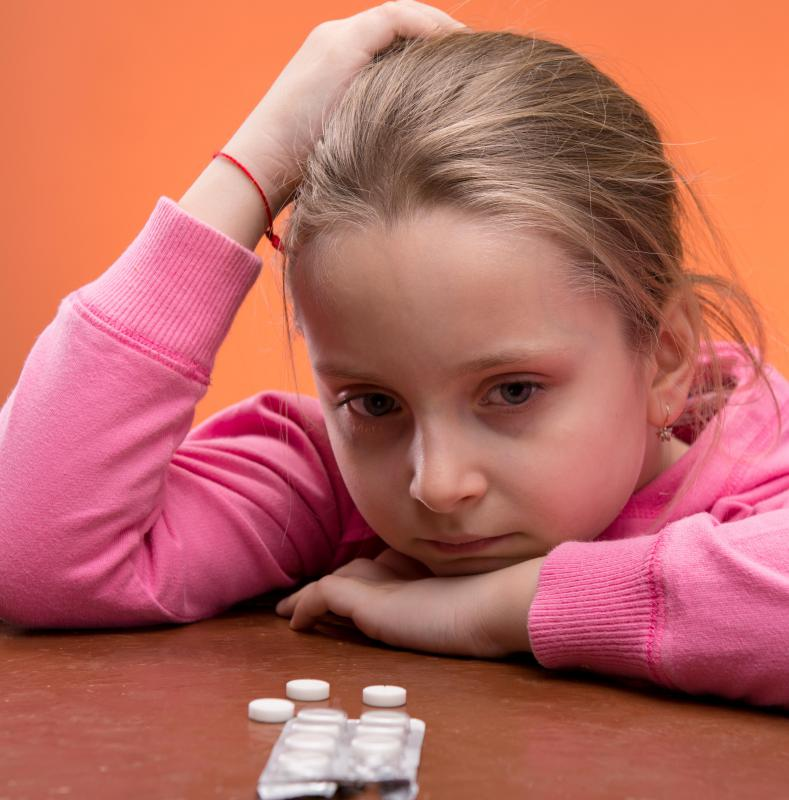 A child psychiatrist may prescribe medication to a child with mental health issues.