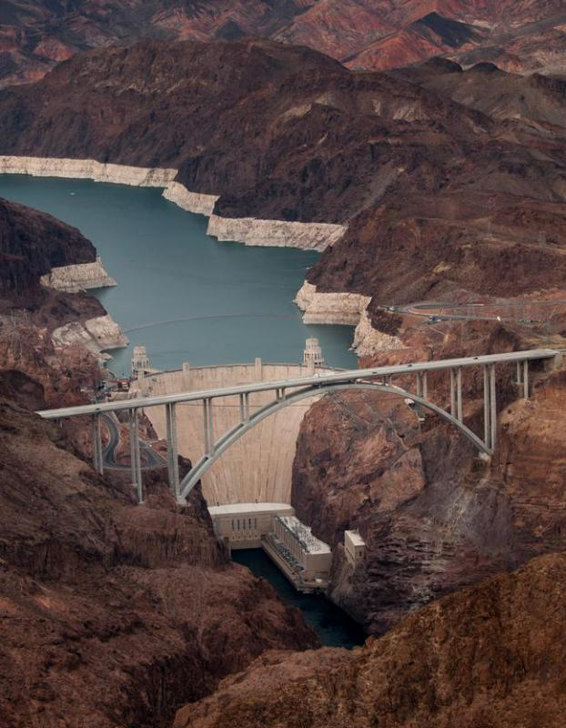 The turbines inside the Hoover Dam were designed by mechanical engineers, however the structure itself was designed by civil engineers.