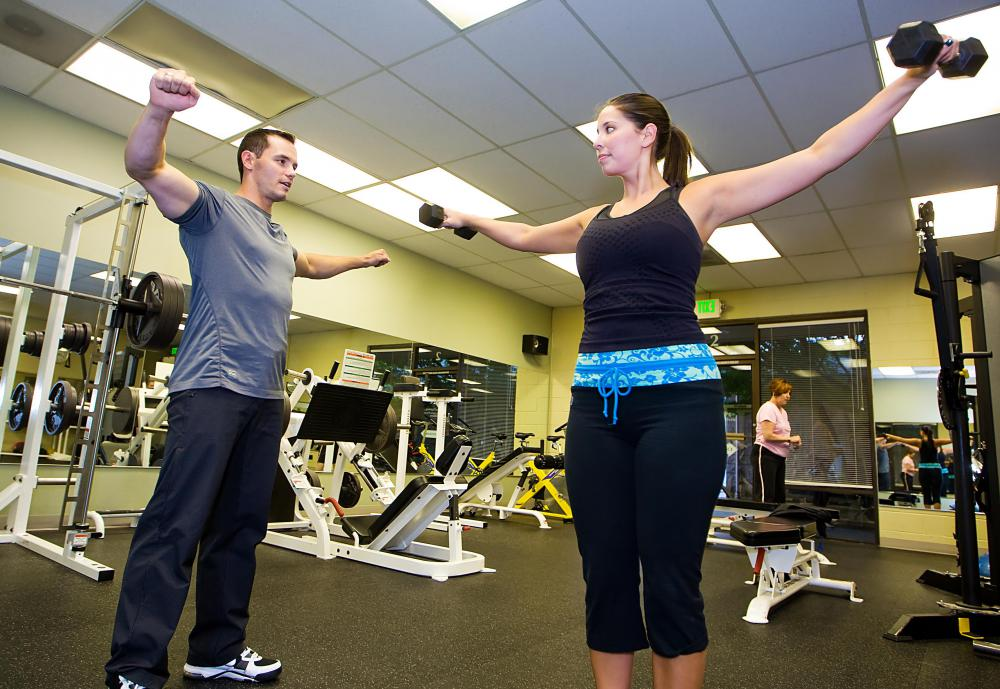 A gym receptionist may help set up a session with a personal trainer.