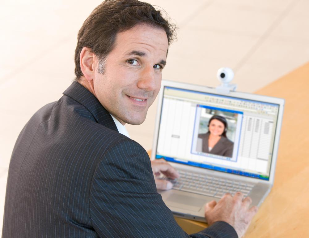 Webcams and video conferencing software can aid a person taking a distance education program.