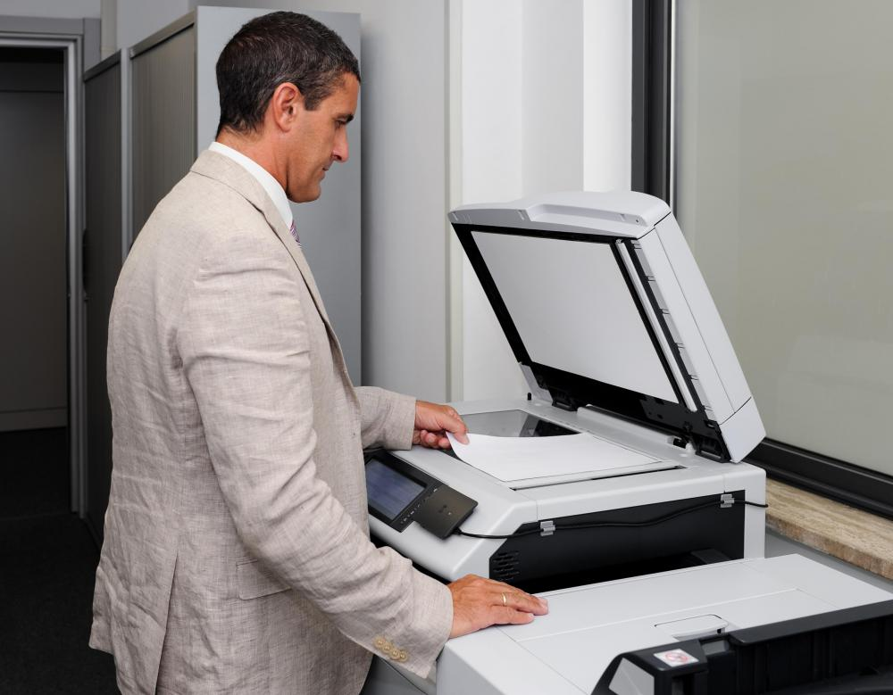 A gym receptionist may produce membership packets for potential new customers.