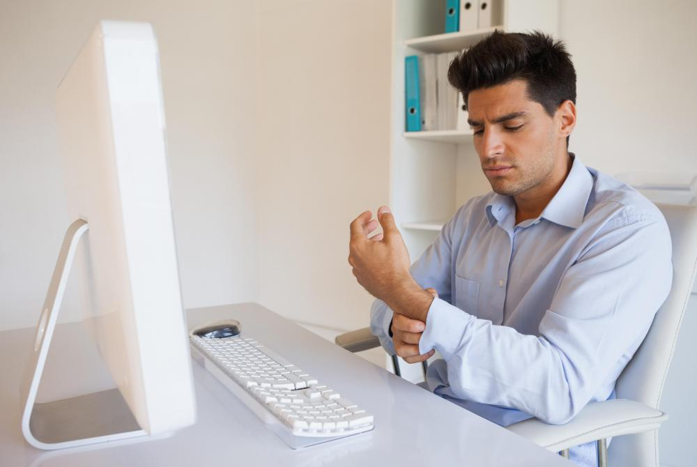 A computer software engineer spends so much time in front of a computer that they may develop carpal tunnel syndrome.