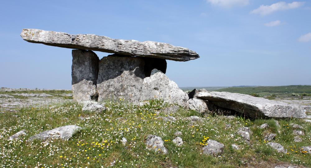 Archaeologists study prehistoric burial sites, such as the megalithic dolmens that can be found throughout Ireland, for clues as to how people once lived.