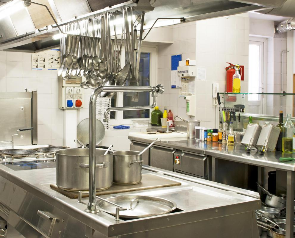 A kitchen steward ensures that workspaces are clean and sanitized.
