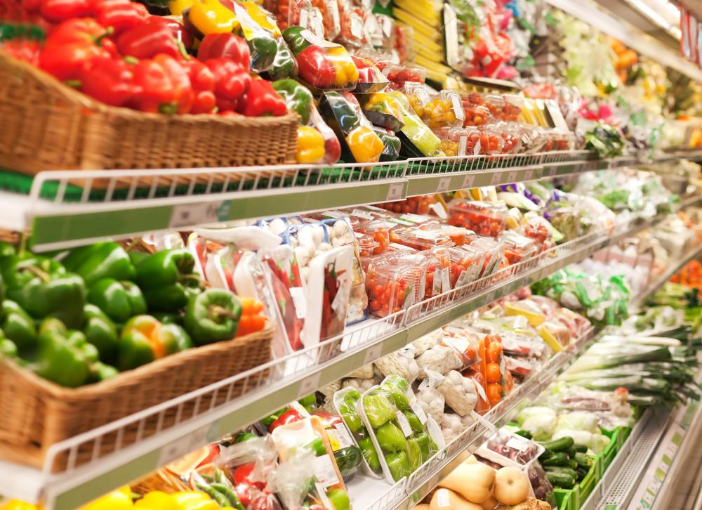 Supermarket managers have many responsibilities, including ensuring that food displays are well stocked and neatly arranged.
