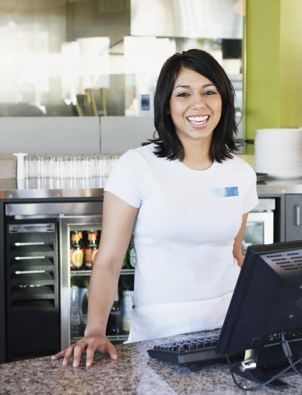 At a small cafe or restaurant, a waitress may not only serve customers but also operate the cash register.