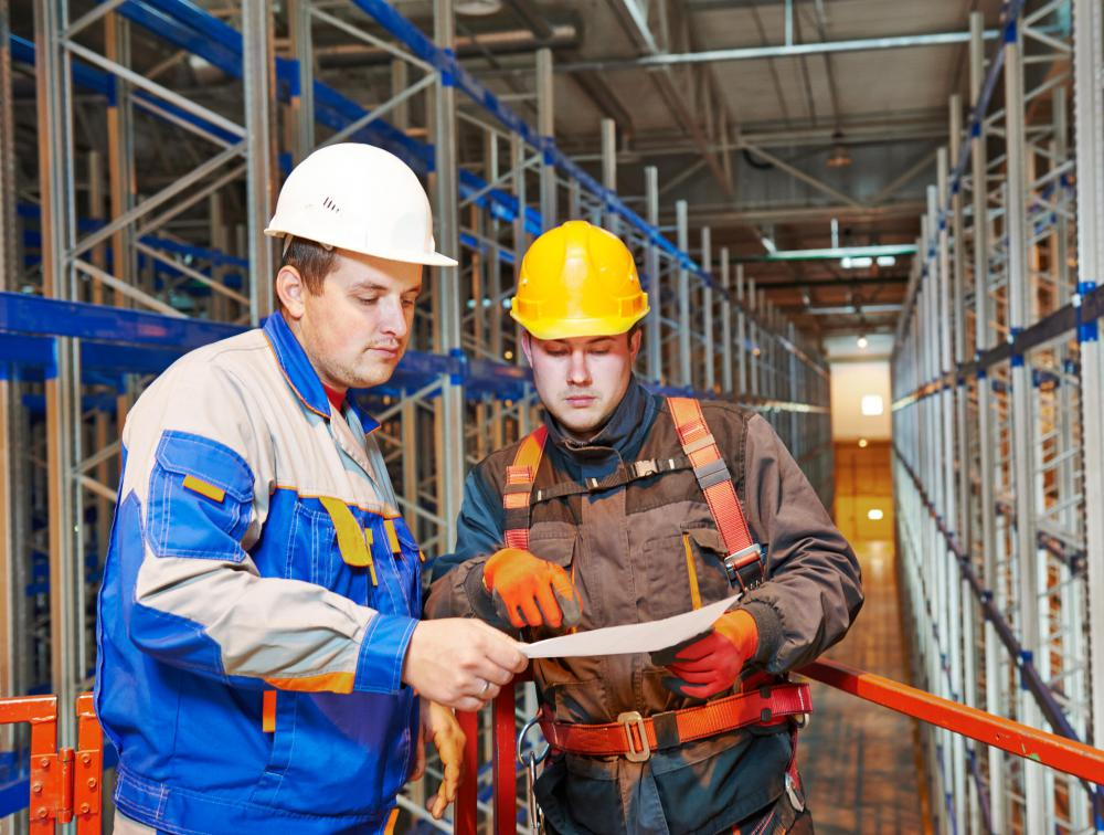A structural engineer may work closely with construction project managers during the design process of a manufacturing plant.