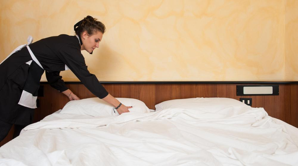 A hotel hostess may pass along guest requests to the housekeeping staff.